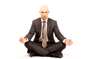 meditating Businessman, isolated against white background